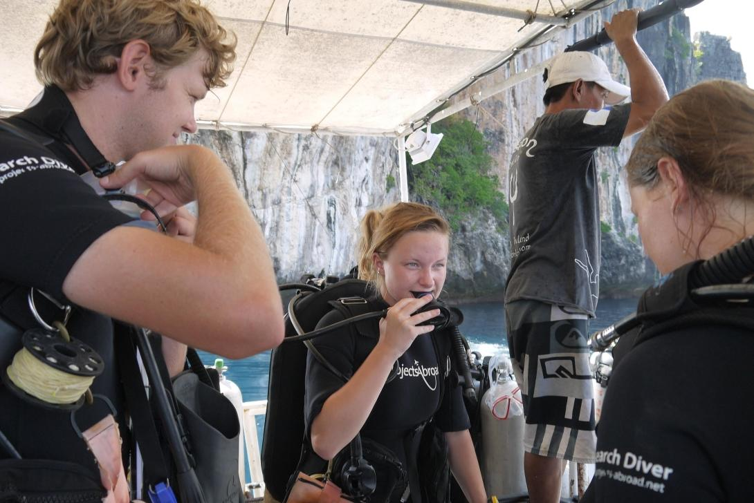 Volunteers preparing for a dive duirng the conservation project